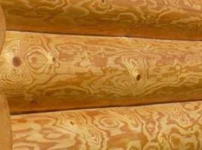 Шлифовка оцилиндрованного бревна – каким инструментом ее лучше осуществлять?